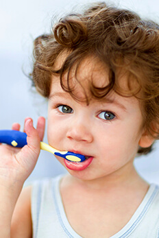 young toddler brushing teeth
