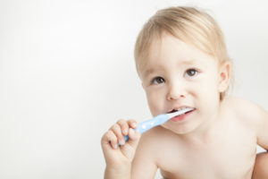 Young child with toothbrush