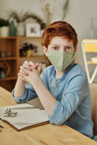 Boy wearing face mask before pediatric dentist in Northampton.