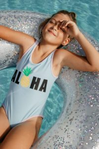 Young girl in pool after visiting pediatric dentist